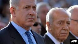 بنیامین نتانیاهو، نخستوزیر (چپ) و شیمون پرز، رئیسجمهوری اسرائیل.