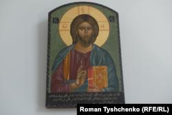 Ікона Христа із арабським текстом у робочому кабінеті