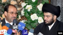 Iraqi Prime Minister Nuri al-Maliki (left) and Shi'ite cleric Muqtada al-Sadr (file photo)