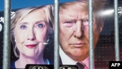 Images of U.S. Democratic nominee Hillary Clinton and Republican nominee Donald Trump behind a security fence where they debated in New York.