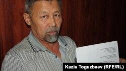 Есенбек Өктешбаев, азаматтық белсенді. Алматы, 4 шілде 2014 жыл.