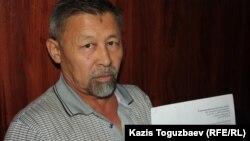 Гражданский активист Есенбек Уктешбаев в Алматинском городском суде. Алматы, 4 июля 2014 года.