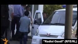 Tajikistan -- Asadullo Ibrohimov entering Sino district court, 21 October 2013
