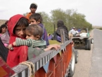 Pakistani families flee their village due to fighting between pro-Taliban militants and security forces in March (epa)