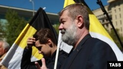 Vyacheslav Maltsev (front) takes part in a Russian opposition rally on May 6.