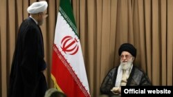 Supreme Leader Ayatollah Ali Khamenei greeting Iranian President Hassan Rohani at a Ramadan ceremony on July 7.