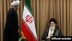 Ayatollah Ali Khamenei və İran prezidenti Hassan Rouhani