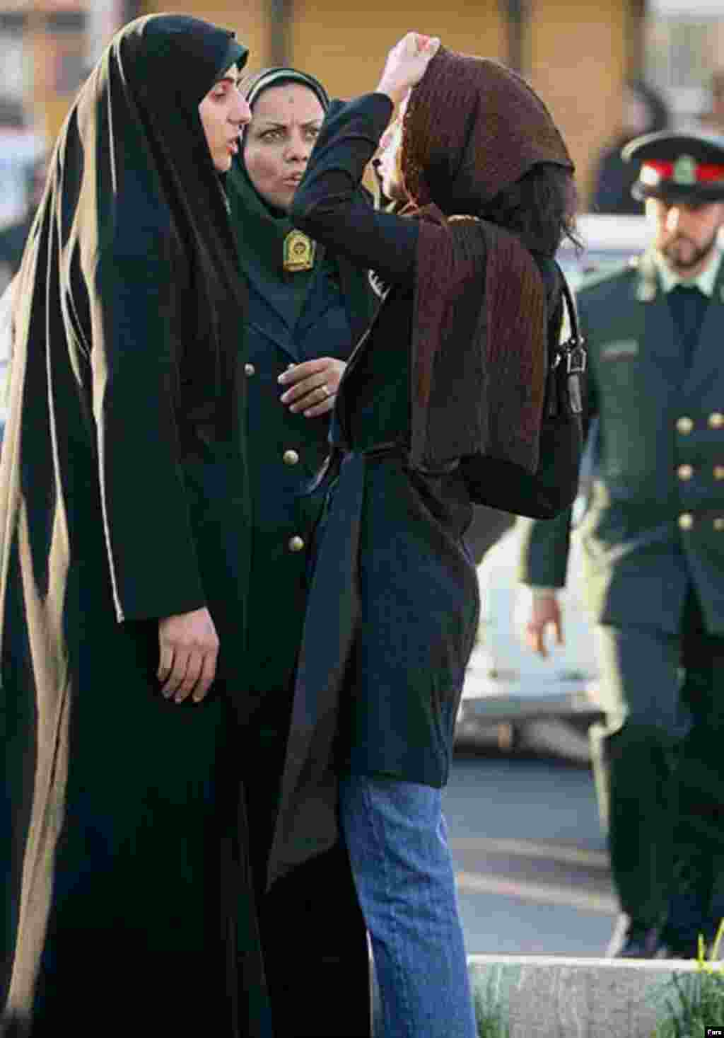 "Police and Basij activists check women for proper dress in Tehran on April 22 (Fars) - Iranian Culture Minister Hussein Saffar-Herandi told the media on April 24 not to undermine the police's public-decency drive with undue criticism. And he threatened them with a firm response if they disseminate what he termed ""divisive"" criticism."