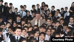 Azeri writer Elchin Huseynbeyli with children