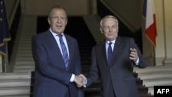 Жан-Марк Еро (П) і Сергій Лавров