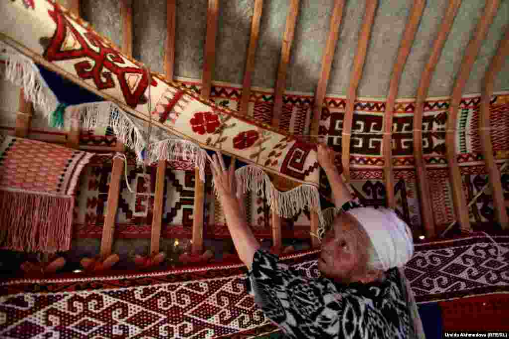 The items displayed inside the yurt, collected by Astara over many years, include gifts to her family and crafts made by her daughters and other relatives.