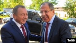 Belarusian Foreign Minister Vladimir Makey (left) and Russian Foreign Minister Sergei Lavrov shake hands as they meet for talks in Minsk on May 16.