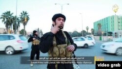 """The two militants are shown directing traffic on a busy road, while the second militant explains that the Muslims in the town """"live in comfort"""" under Shari'a law."""