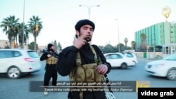 "The two militants are shown directing traffic on a busy road, while the second militant explains that the Muslims in the town ""live in comfort"" under Shari'a law."