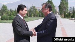 Turkmenistan's Gurbanguly Berdymukhammedov (left) and Tajikistan's Emomali Rahmon in Dushanbe on May 5 -- new best friends forever?