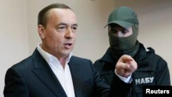 Former lawmaker Mykola Martynenko speaks during a court hearing in Kyiv on April 21.