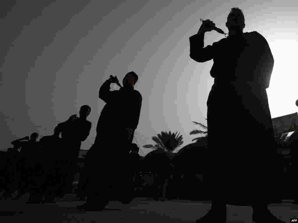 Shi'ite men ritually whip themselves with chains in an effort to share the suffering of Hussein, demonstrate piety, and spurn the trappings of the flesh and worldly concerns.