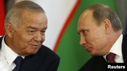 Russian President Vladimir Putin (right) and his Uzbek counterpart Islam Karimov at the Kremlin in Moscow on April 15.
