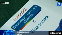 "A TV grab shows the cover of a Romanian-language translation of a French reference book titled ""A Family Medical Encyclopedia, Vol. II: Sex Life,"" during a press conference in the city of Balti on March 13."