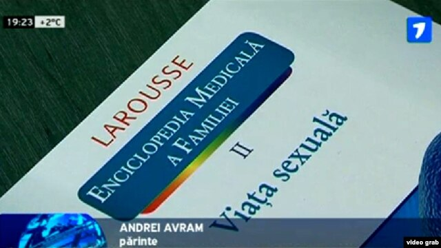 A TV grab shows the cover of a Romanian-language translation of a French reference book titled 'A Family Medical Encyclopedia, Vol. II: Sex Life,' during a press conference in the city of Balti on March 13.