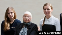 Left to right: Maria Paraskevich and Maria Grigorieva, the daughter and mother of Tatiana Paraskevich, with Lyudmyla Kozlovska, president of the Open Dialog Foundation.