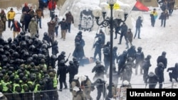 Police clash with supporters of former Georgian President Mikheil Saakashvili in a tent camp in front of the Ukrainian parliament in Kyiv on February 27.
