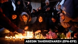 Iranians light candles for victims of Ukraine International Airlines Boeing 737-800 as they protest in front of Amir Kabir University in Tehran, Iran, 11 January 2020.