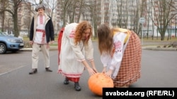 Women in national garb roll out a pumpkin in front of the Russian Embassy in Minsk on December 5 in a protest over possible deepening integration. In local custom, when a woman presents a man with a pumpkin, she's telling him he's undesirable.