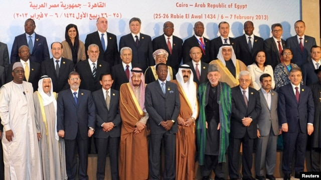 President Muhammad Morsi stands with other leaders of Islamic nations for a group photo before the opening of the Organization of Islamic Cooperation summit in Cairo.