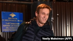 Russian opposition leader Aleksei Navalny leaves a detention center in Moscow early on October 14.