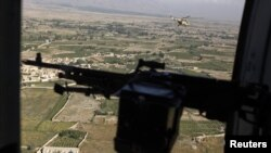 A Taliban spokesman claimed the helicopter was shot down by rocket fire and burst into flames.