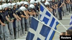 Antiausterity demonstrators confront riot police near the Greek parliament in Athens.