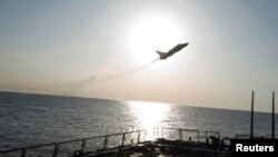 An U.S. Navy picture shows what appears to be a Russian Sukhoi SU-24 attack aircraft flying close to the U.S. guided missile destroyer USS Donald Cook in the Baltic Sea on April 12.