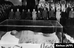 Party and state leaders stand vigil before the remains of Mao Zedong on September 13, 1976.