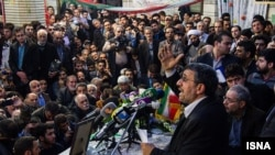 Mahmoud Ahmadinejad addressing his supporters at a sit in in Share Rey, near Tehran.