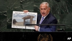 Israel's Prime Minister Benjamin Netanyahu shows an atomic warehouse in Teheran during his address the 73rd session of the United Nations General Assembly, at U.N. headquarters, Thursday, Sept. 27, 2018. (AP Photo/Richard Drew)