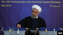 Iranian President Hassan Rohani casts his votes in Tehran.