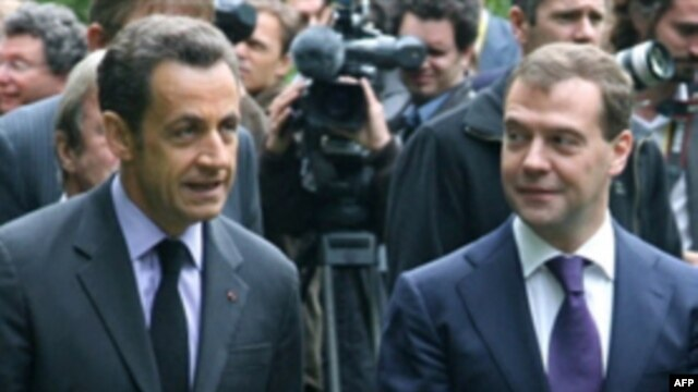 President Nicolas Sarkozy (left) wants the resumption of talks to be the centerpiece of the summit with Russia.