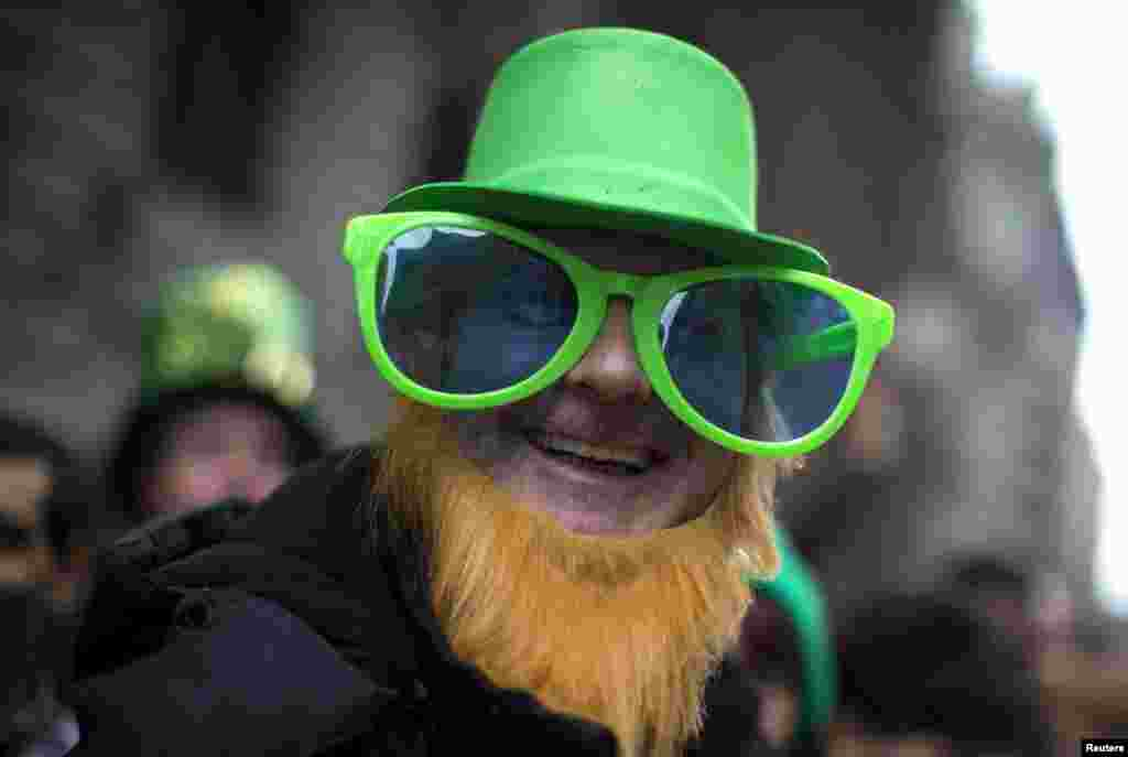 Carl McCormack from Scotland wears a St. Patrick's Day costume as he stands with thousands of spectators to watch the New York City St. Patrick's Day parade up 5th Avenue in Manhattan. (Reuters/Mike Segar)