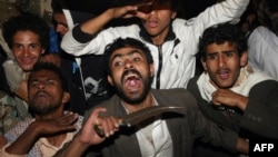 Yemeni antigovernment protesters react angrily to the news that President Ali Abdullah Saleh had signed a power transfer deal on November 23.