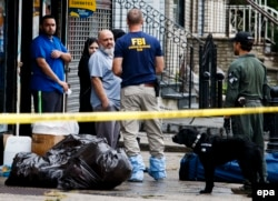 Mohammed Rahami (third from left), the father of the suspect behind the September 17 explosion in New York City and a second bombing in New Jersey, talks with FBI investigators in Elizabeth, New Jersey.