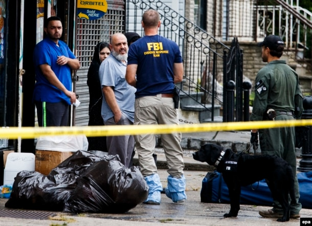 Mohammed Rahami (third from left), the father of Ahmad Khan Rahami, talks with FBI investigators in Elizabeth, New Jersey.
