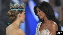 Miss Venezuela, Ivian Sarcos (right), is congratulated by Miss World 2010, Alexandria Mills of the United States, after winning Miss World 2011 in London.