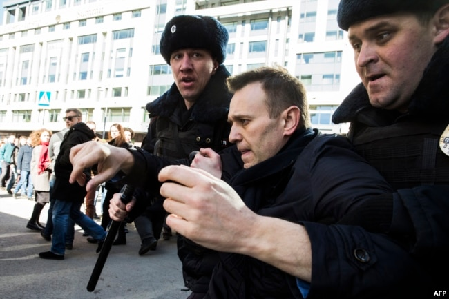 Kremlin critic Aleksei Navalny is detained during an anticorruption rally in central Moscow on March 26.