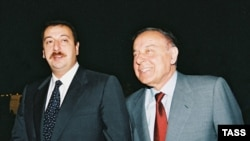 Heydar Aliyev (right) with his son Ilham in 2003