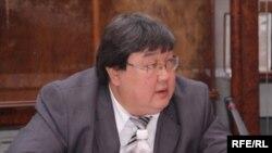 Зайнидин Курманов.