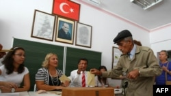 A man casts his referendum vote in Ankara.