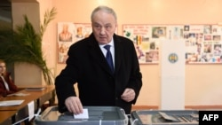 Moldovan President Radu Timofti casts his ballot in the presidential election at a polling station in Chisinau on October 30.