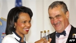 U.S. Secretary of State Condoleezza Rice and her Czech counterpart, Karel Schwarzenberg, toast after signing the missile-defense deal in Prague on July 8