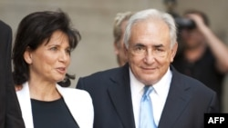 Dominique Strauss-Kahn and his wife, Anne Sinclair, leave the New York State Supreme Court in New York on July 1.